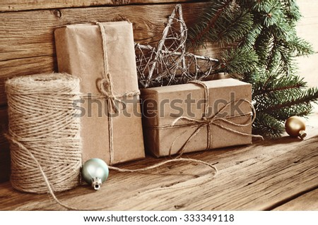 Christmas gifts on a wooden table close-up. Christmas Present - stock photo