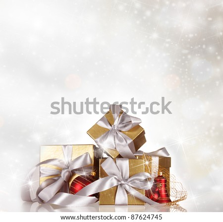 Christmas gifts on snow background
