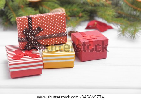 Christmas gifts on the background of New Year's still-life. - stock photo