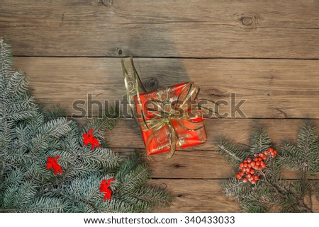 Christmas gifts on the background of the old wooden planks
