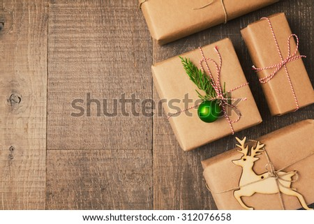 Christmas gifts on wooden background. View from above - stock photo