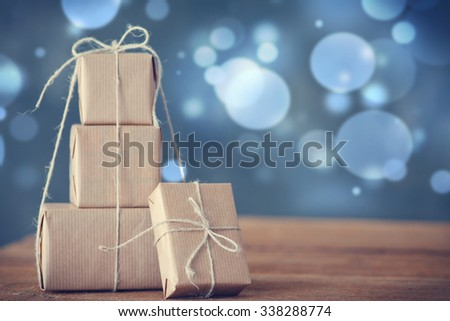 christmas gifts  on wooden board - stock photo
