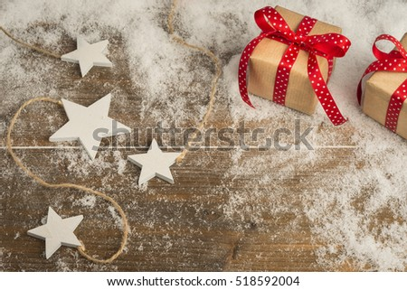 christmas gifts , stars ornaments on wooden floor