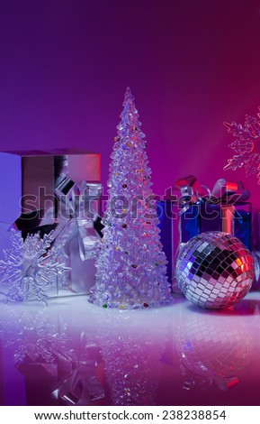 Christmas gifts, toys and decorations on a purple background - stock photo