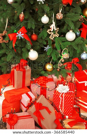 Christmas gifts under the fir tree in living room