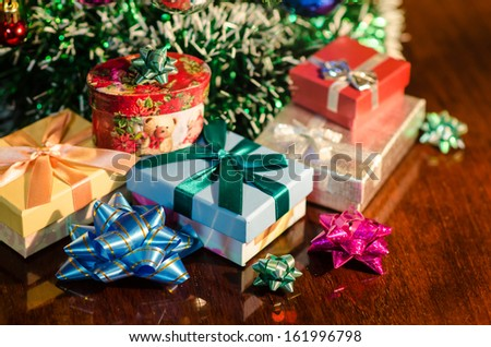 christmas gifts under tree - stock photo