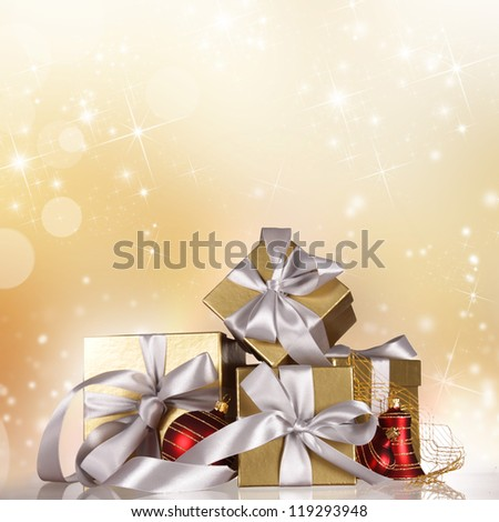 Christmas gifts with falling snowflakes. - stock photo