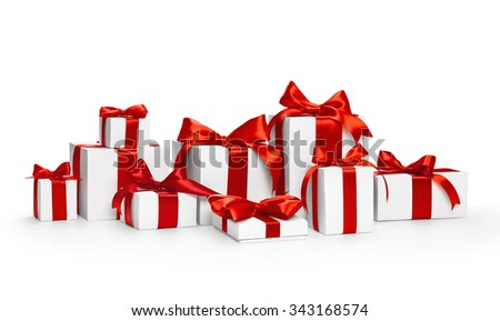 Christmas gifts with red ribbons isolated on white - stock photo
