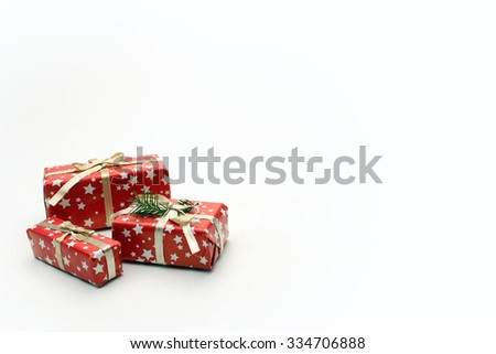 Christmas gifts wrapped in red decoration paper isolated on white background with space for text. - stock photo