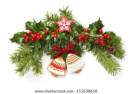 Christmas ginger bells and holly branch decoration - stock photo