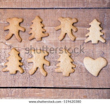 Christmas ginger biscuits on a wooden surface