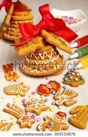 Christmas gingerbread bell and cookies - stock photo