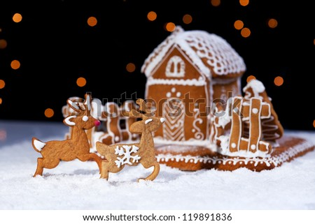 Christmas gingerbread cookie house and deers - holidays food setting