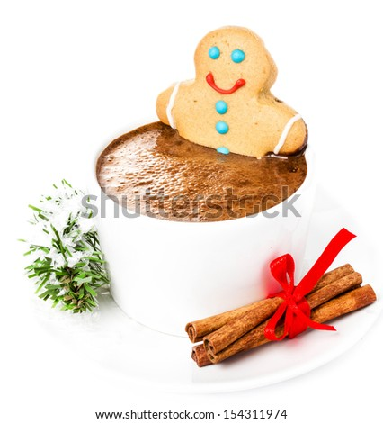 Christmas Gingerbread Cookie Man and hot chocolate,  cinnamon and christmas tree branch, closeu��· (with easy removable sample text)  - stock photo