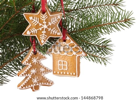 Christmas gingerbread cookies hanging on branch - stock photo