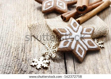 Christmas gingerbread cookies in star shape on rustic wooden table. Xmas cozy mood, festive atmosphere. Copy space - stock photo