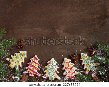 Christmas gingerbread cookies in the shape of a Christmas tree, new year decorations on wooden background top view - stock photo