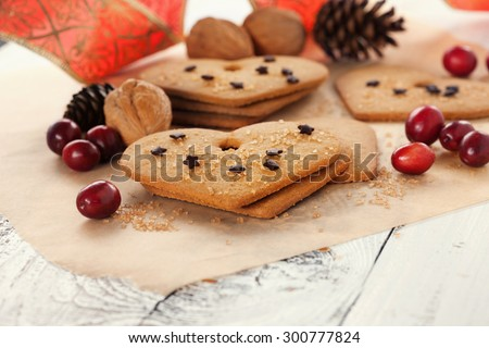 Christmas gingerbread cookies on old rustic wooden background, selective focus - stock photo