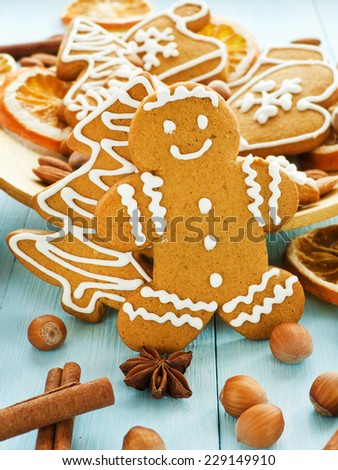 Christmas gingerbread cookies on the blue background. Shallow dof. - stock photo
