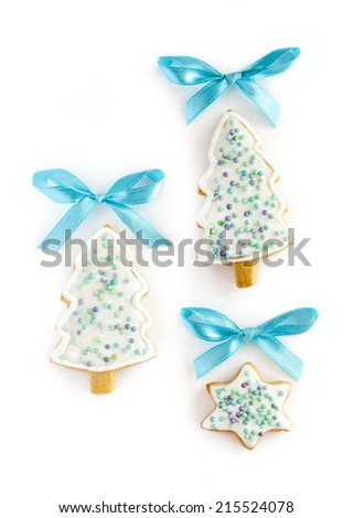 Christmas gingerbread cookies on white background. Firtree, bows, star shapes - stock photo