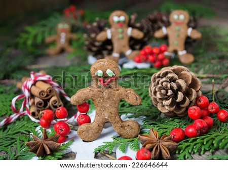 Christmas gingerbread cookies on wooden background with fir-tree - stock photo
