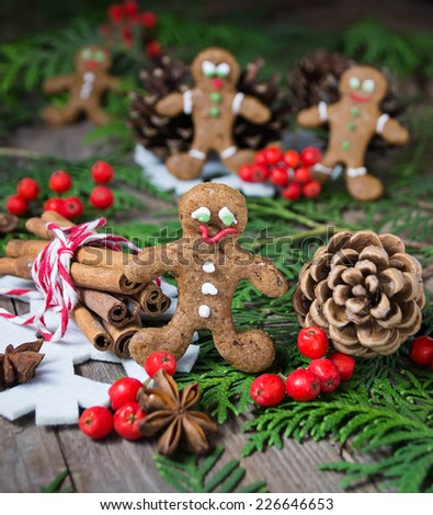 Christmas gingerbread cookies on wooden background with fir-tree