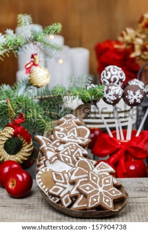 Christmas gingerbread cookies on wooden tray. Selective focus - stock photo
