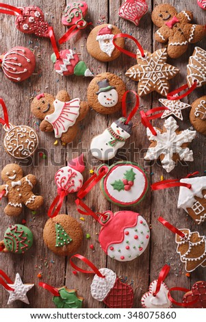 Christmas gingerbread on wooden background close-up. Vertical view from above