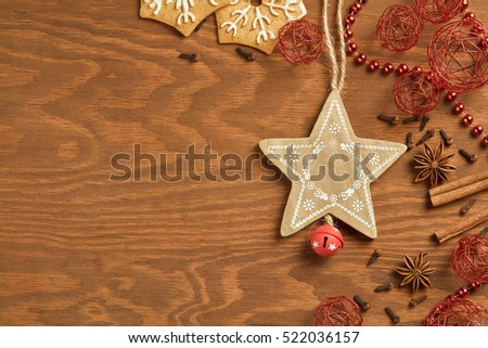 Christmas gingerbread on wooden background with various decoration and spices