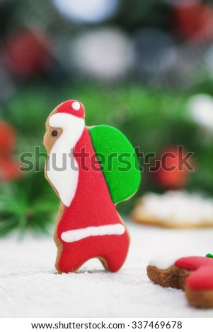 Christmas gingerbread Santa Claus cookies on a bed of snow with copy space - stock photo