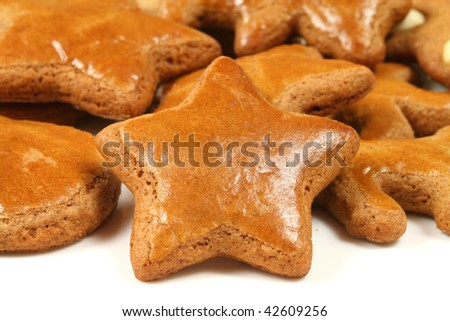Christmas gingerbread star isolated on white - traditional baked cookies - stock photo