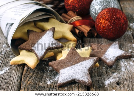 Christmas gingerbread star shape cookie on the wooden table.Selective focus on the front star cookie - stock photo