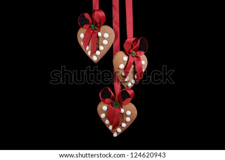 Christmas gingerbreads on the black background