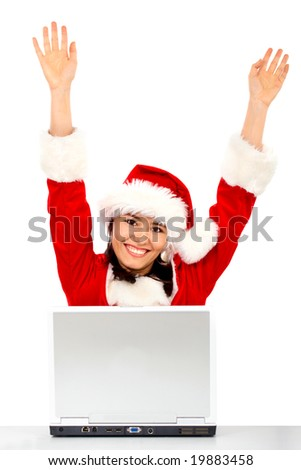 christmas girl happy with her success while working on a laptop - isolated over a white background - stock photo