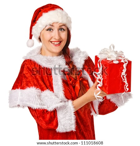Christmas girl holding gift wearing Santa costume. Isolated over white background
