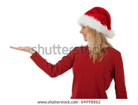Christmas girl wearing Santa hat, holding hand palm up, ready to hold a present. - stock photo