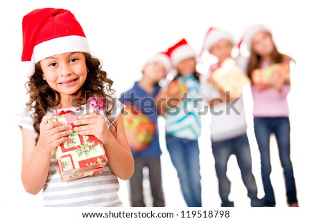 Christmas girl with a gift and her friends at the background - isolated over white - stock photo