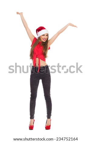 Christmas girl with arms outstretched. Full length studio shot isolated on white. - stock photo
