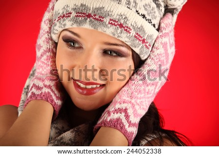 Christmas girl with knitted gloves, studio, portrait