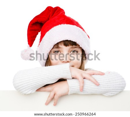 Christmas girl with santa hat behind white board looking at camera. isolated on white background - stock photo