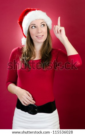 christmas girl with santa hat shows up - stock photo