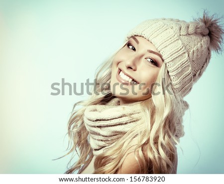 christmas girl, young beautiful smiling and give a wink over blue background, toned - stock photo