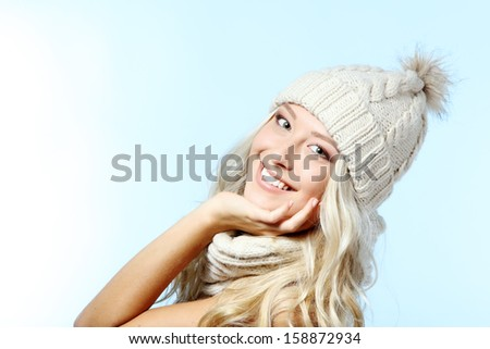 christmas girl, young beautiful smiling and looking at camera over blue background - stock photo