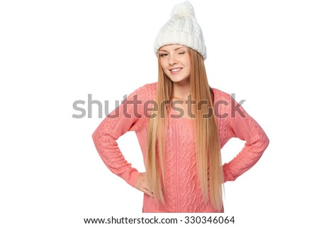 Christmas girl, young beautiful smiling woman giving a wink over white background - stock photo