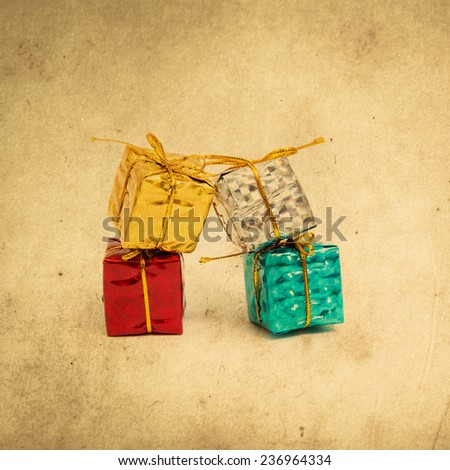 Christmas give boxes. Grunge paper filter. - stock photo