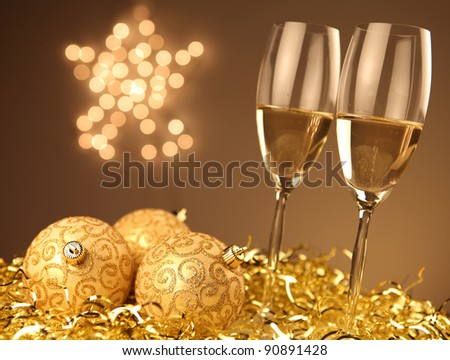 Christmas glasses of Champagne and golden background - stock photo