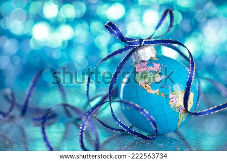 Christmas Globe in blurred blue lights background.  - stock photo