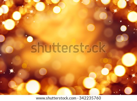 Christmas glowing Background. Golden Holiday Abstract Glitter Defocused Background With Blinking Stars. Blurred golden Bokeh  - stock photo