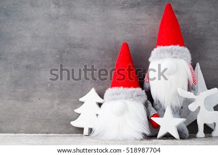 Christmas gnome decor with santa hat. Holiday bohek background.