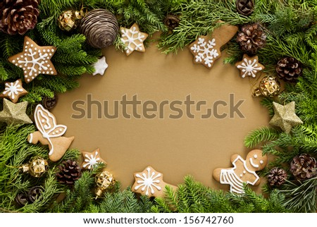 Christmas gold background with firtree, gingerbread cookies, decoration.  - stock photo